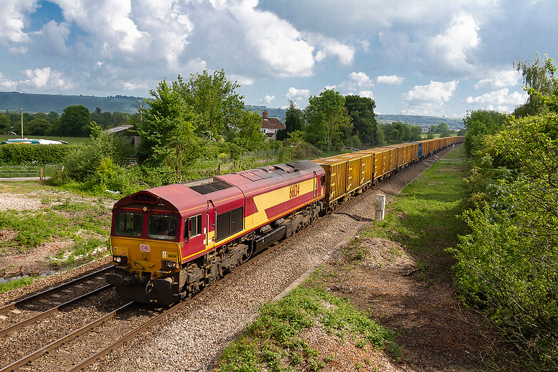 27th May 2918:  Running into a fortunate patch of sunshine at Heywood is 66134  bringing 6C03 the rubbish train from Southall TC to Severnside Sita.  Due to electrification works the service was diverted to run down the Berks & Hants line.