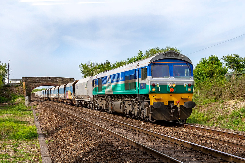17th May 2018:    Passing under the Church Road bridge in Heywood  is 59002 'Alun J Day'.  Normally 7C77 is routed via the Berks & Hants line but as this is closed for the week this Acton to Merehead has travelled  vis Swindon at then the Somerset and Weymouth line from Thingley Junction .