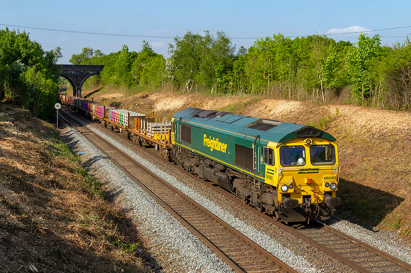 20th May 2018:  Recent tree clearance is opening up this shot again from the foot bridge over the Frome Avoider at Styles Hill.  6X04 is in the hands of 66550 Top & Tailed 66568 and a long mixed rake of track replacement parts.  Starting from Ruscombe, just east of Twyford, it isgoing to Fairwater Yard in Taunton.