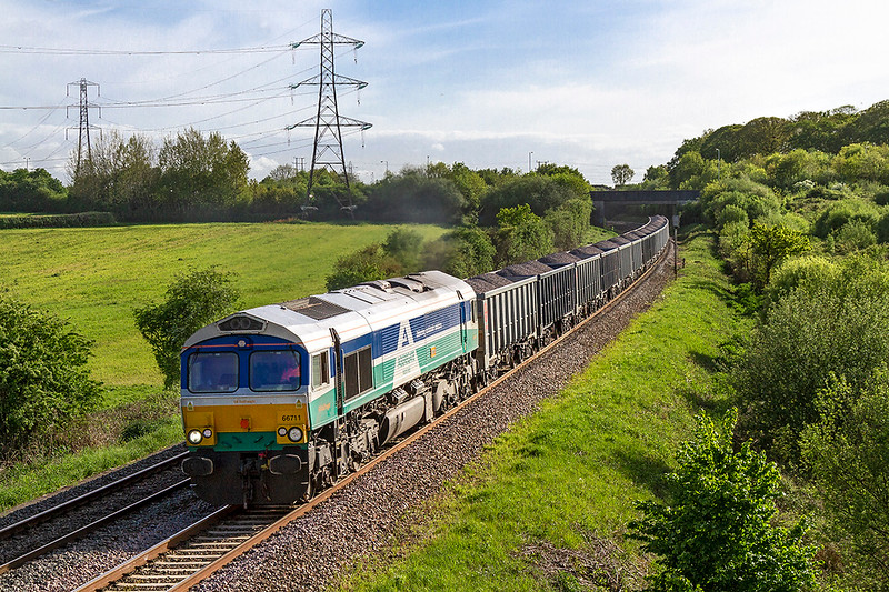 10th May 2018:  Accelerating away from Clink Road Junction is. 66711 'Sense' on the point of 6M41 from Whatley to Wellngborough
