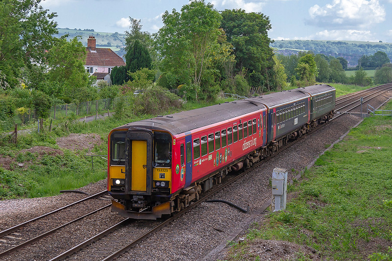 27th May 2018:  An unusual hybrid 3 car unit is forming 2V83 the 14.14 Weymouth to Bristol Temple Meads.   3 x 153s in three different liveries with 153325 on the front are pictued at Heywood.  Some sunshine would have be appreciated !