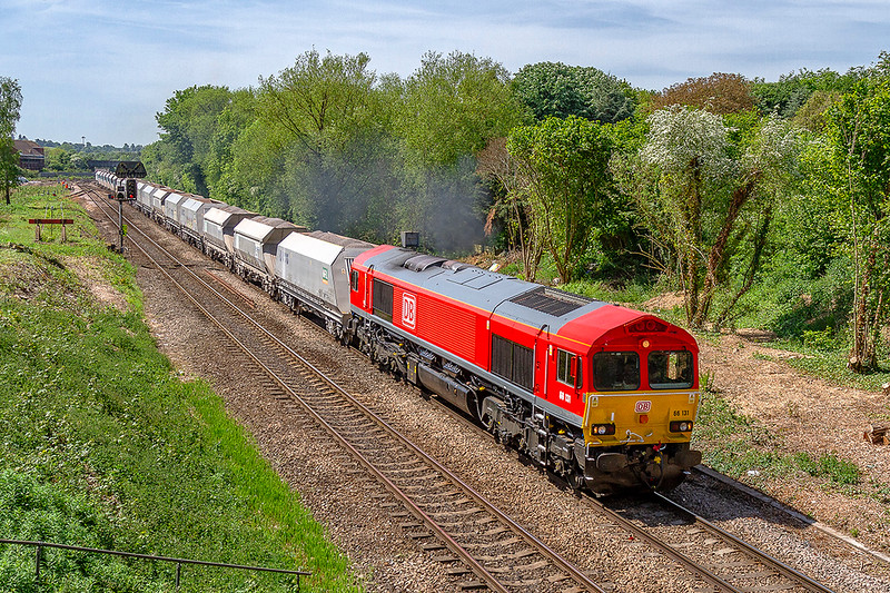 17th May 2018:  Very recently repainted 66131 is nearing Hawkeridge Junction as it works to Acton from Whatley Quarry.  Normally this train will go via the Berks & Hants line but this is closed all the week for engineering works.