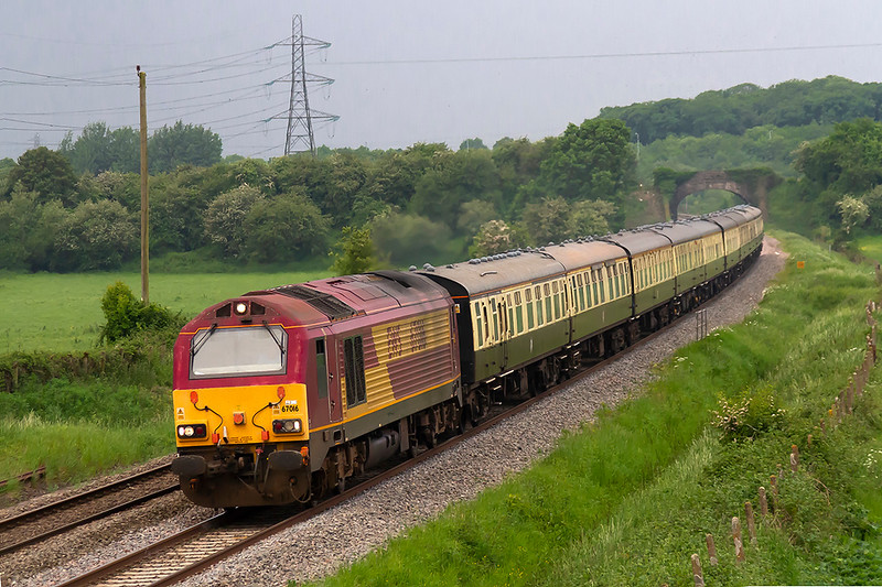 26th May 2018:  Theday's 'Quantock Explorer' Cathedrals Express from Paddington to Minehead used 35028 'ClanLine' for the out ward leg but 67016 provided the urge for the return.  1Z27 is pictured as it runs through Berkley to the East of Clink Road Junction. A minute later there was a tremendous thunder storm !