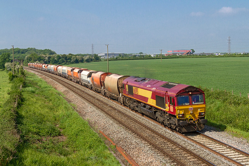 23rd May 218:  Getting away from the Whatley Quarry line at Clink Road Junction 66098 is captured from the Pot Lane bridge in Berkley as it takes 6M20 to Hayes & Harlington