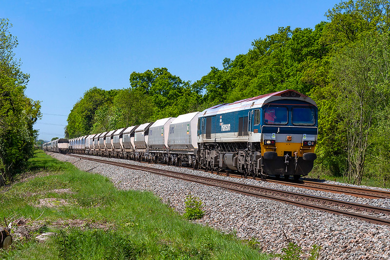 14th May 2018:  59102 is heading to Wootton Bassett with 7B12 from Merehead  Quarry.  The  ocation is Masters Criossinf just west of Fairwood Junction.