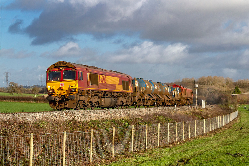 30th Nov 2018:  Now on the Westbury to St Blazey leg of 3J13s  moring activity 66200 & 66104 are pictured at Bunns Lane on the climb away from Blatchbridge Junction in Frome