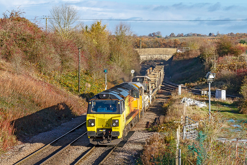 11th Nov 2018:  Crossing Hawkeridge Junction is 70810 as it brings 6C97 from Dolphin Junction,near,  Slough, to Westbury.  The empty LWR set will probably be taken to Eastleigh tomorrow on 6O41.