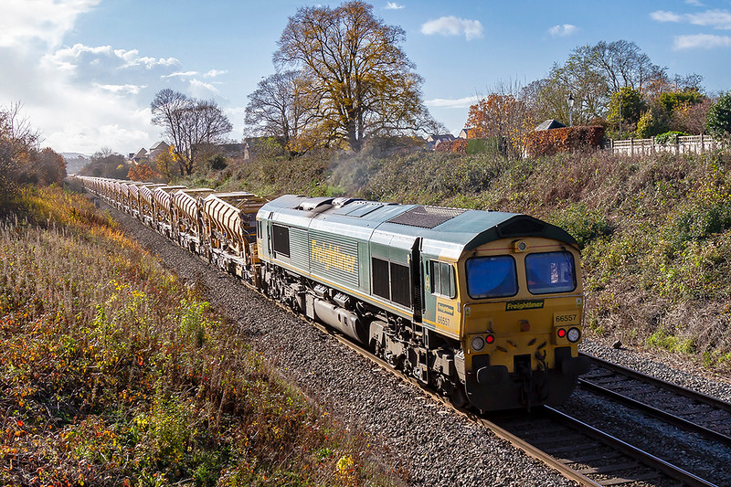 11th Nov 2018:  Captured from the foot bridge on the Frome Cut Off AKA Avoider is 66557 on the rear of  the full HOBC on it's way to Fairwater Yard from Didcot West Curve Junction.  Out of sight on the front is 66509