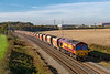 24th Oct 2018:  With the old RMC hoppers in tow 66023 travels East through Berkley as it takes 6M26 from Whatley Quarry to Hays & Harlington Tarmac Sidings