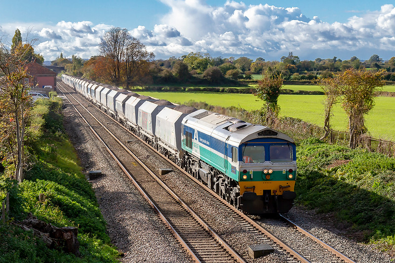 26th Oct 2018: Running through the site of Edington and Bratton station on the Berks & Hants line is 59005 'Kenneth J Painter' on the point od 6L21 from Whatley Quarry to Dagenham Dock R M C'. On the right the black spear fencing that lined the platform can still be seen