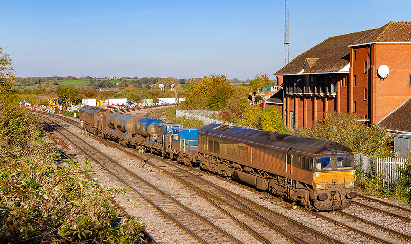 21st Oct 2018:  Blending in very well with the Autumnal colours are 66847 (leading) and 66850 as they leave Westbury. The  RHTT working, 3S59, based on Barton Hill in Bristol normally starts the working by covering the Welsh Valleys and Hereford before returning to Bristol to cover the local lines but on Sunday the order is reversed.  Today the leg to Chippenham was cancelled  to the train was leaving Westbury  1 1/2 hours early.