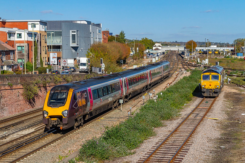 22nd Oct 2018:  Running 10 minutes late as it passes trough Eastleigh is Cross Country service 1O10 the 08.27 from Manchester Piccadilly to Bournemouth in the hands of 220034.  Waiting on the right o leave the yard is 66741.