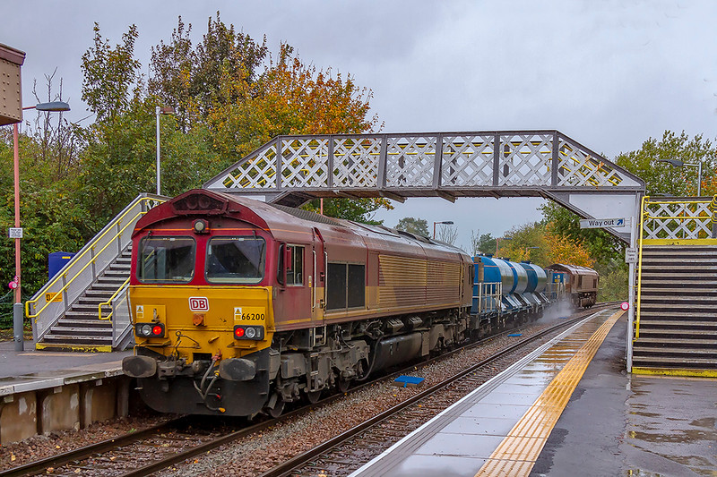 12th Oct 2018:  66200 is bringing up the rear of 3J13 as it runs through Warminster woth the 'Squirter' heading back to St Blazey