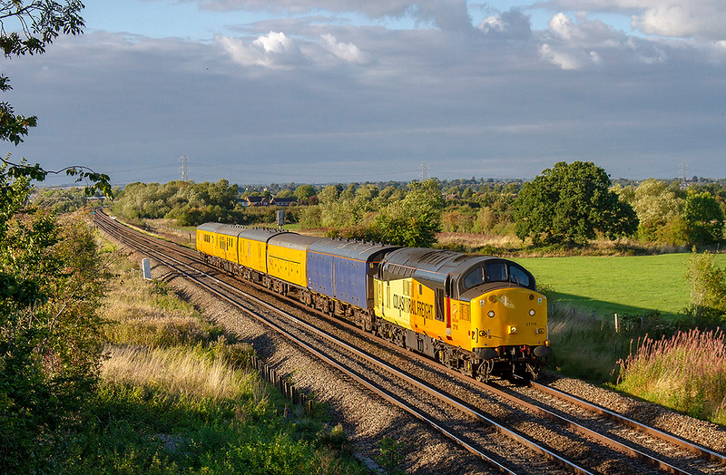 13th Sep 2018:  In beautiful evening light 37116 working 3Q14  from Westbury to Westbury via Weymouth and a brief trip to Thingley Junction nears Westbury.  The picture is taken from the Church Road bridge in Heywood.  The blue barrier coach, giving additional brake force, makes a welcome and unusual addition the the train