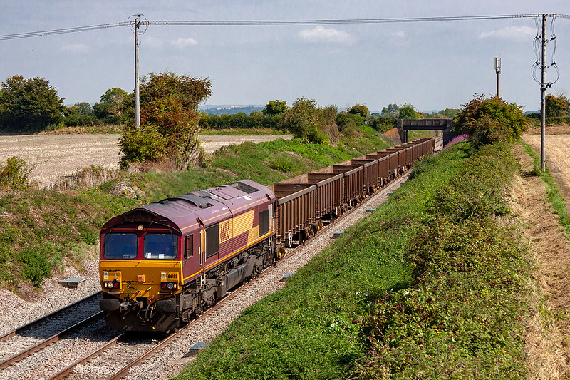 3rd Sep 2018:   Today is the first time that this flow has run,  66155 is taking the empty boxes from Didcot to Bristol East Depot  down the Berks & Hants and is captured at Edington