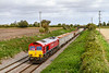 21st Sep 2018:  66152 was the first EWS shed to be repainted into the Schenker red livery almost 10 years ago and still looks to be in good condition.  Missing the sun by a couple of minutes it truns through Edington in charge of 6C58 from Oxford Banbury Road to Whatley