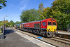 24th Sep 2018:  Running through Warminster is 6O41 the daily departmental from Westbury to Eastleigh West Yard operated by DB Cargo.  Today was rather unusual in that it had Freightliner 66505 DIT at the head of the consist.