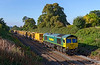 7th Sep 2018:  66591 brings 6C72 from Fairwater Yard in Taunton up the  grade on the Frome avoider towards Clink Road  Junction at Styles Hill.  wagons will geta ballast refill at the Westbury virtual quarry