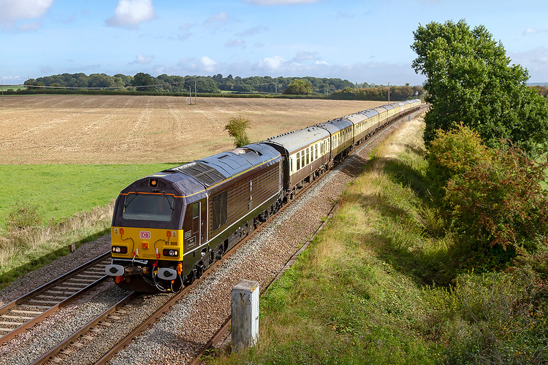 15th Sep 2018:   The UK Railtours 'The Torbay Flyer' ,running from Letchlade to Paignton, is on time as it passes through Berkley Marsh near Frome.  Providing the urge is an imaculate 67006 'Royal Sovreign', the rake looks good also even though the 8th coach is actually in 'Blood & Custard' .