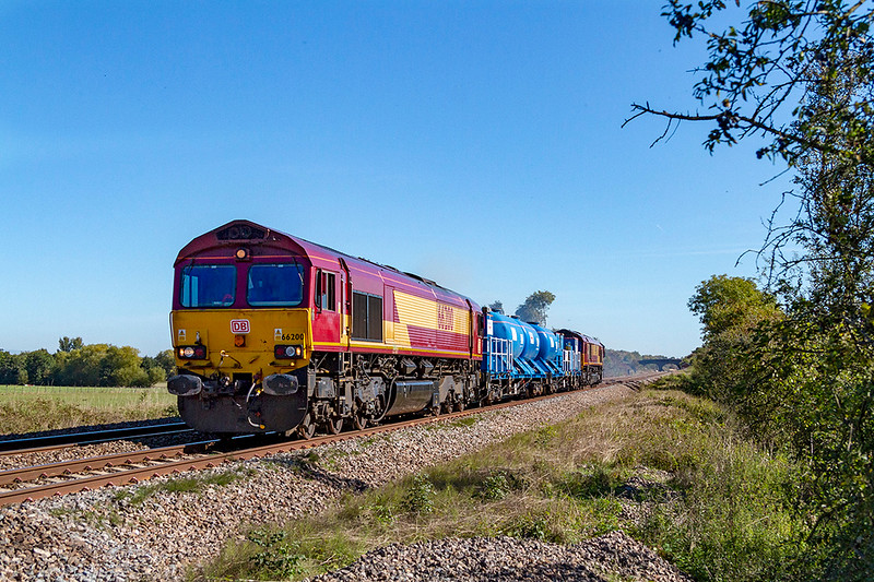 26th Sep 2018:  Making it's way to St Blazey is 3J13 from Westbury.  The RHTT set has 66200 leading and 66120 on the other end..  I wonder when it will start the spraying duty as it was not when passing me at Masters Xing just west of Fairwood Junction