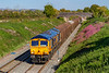 27th Sep 2018:  Yet again 66774 is entrusted with 6V30 from Tilbury I,R.F.T to Trostre Works.  Captured from the Lambourne Lane bridge in Edington