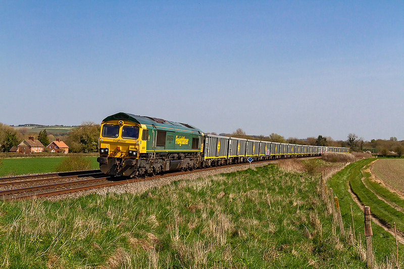 1st Apr 2019:  Another new service is 6V44 from Southampton Up Yard to Stoke Gifford operated by Freightliner.   With 66618 at the helm, and will all the brand new IWA-B bocxes not yet covered in graffiti, it is seen at Bapton in the Wylye Valley .