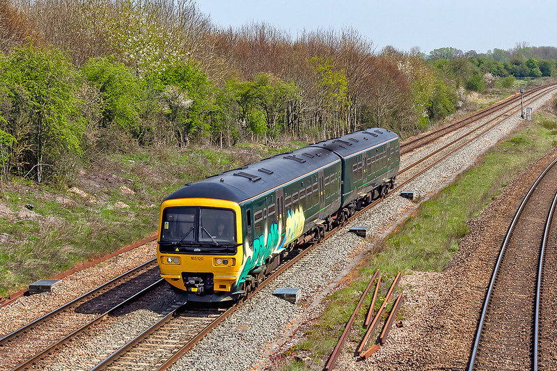 19th Apr 2019:  165120 has been attacked by the 'Brain Deads'.   Pictured at Fairwood Junction as it worls 2O89 the 10.42 Gloucester to Weymouth
