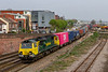 18th Apr 2019:  The 7.15 am from Birch Coppice to Southampto MTC,4O05. powered by 70006 is pictured as it departs from Eastleigh.  The pink 'ONE' shows up very well.
