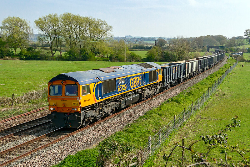15th. Apr 2019:  the 07.50 from Wellingborough is coded 6M42 and is going to Whatley Quarry near Frome in Somerset.  With 66727 'Derby County' on the point it is pictured at Great Cheverel in West Wiltshire