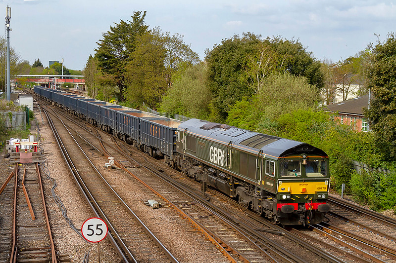 18th Apr 2019:   Running south through St Denys station is the last 'new build' class 66 number 66779 'Evening Star'.  It is working 6Y19 from Mountfield to Southampton where the boxes will be refilled with Gypsum.  On the front is an 82F shed plate like the one carried by the original 9F 92220 E'vening Star' that worked the last ever 'Pines Express' from Bath to Bournemouth on the Somerset and Dorset line.<br /> <br /> Dorset line