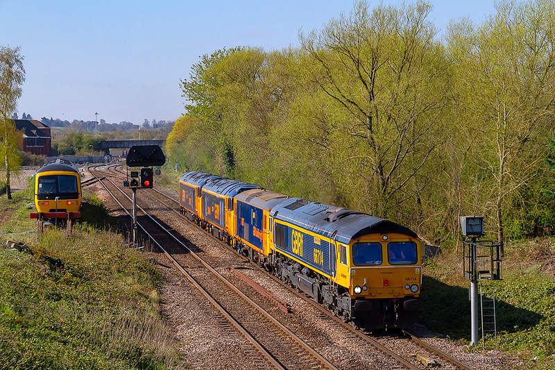 """12th Apr 2019:   66714 """"'Cromer Lifeboat' is taking 73107 'Tracey'  and newly repainted 50049 'Defiance' 50007 'Hercules', from Easteligh to Long Rock for the 'Open Day'  0Z50 is at Hawkeridge Junction. 165137 is parked in the short 'Trowbridge Siding'"""