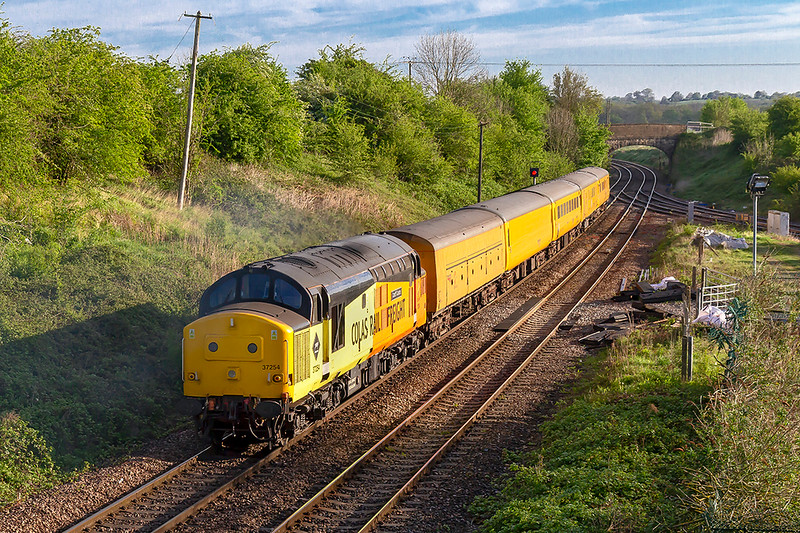 26th Apr 2019: at 07.44 Colas Tug 37254  passes through Hawkeridge Junction towards Bristol.  It is working 3Q38 that started from Westbury at 23.45 and tracelle had been to Basingstoke, Ludgershall and Romsey and is now going to Bristol High Level Siding for a rest.  DVT 9708 is on the front.