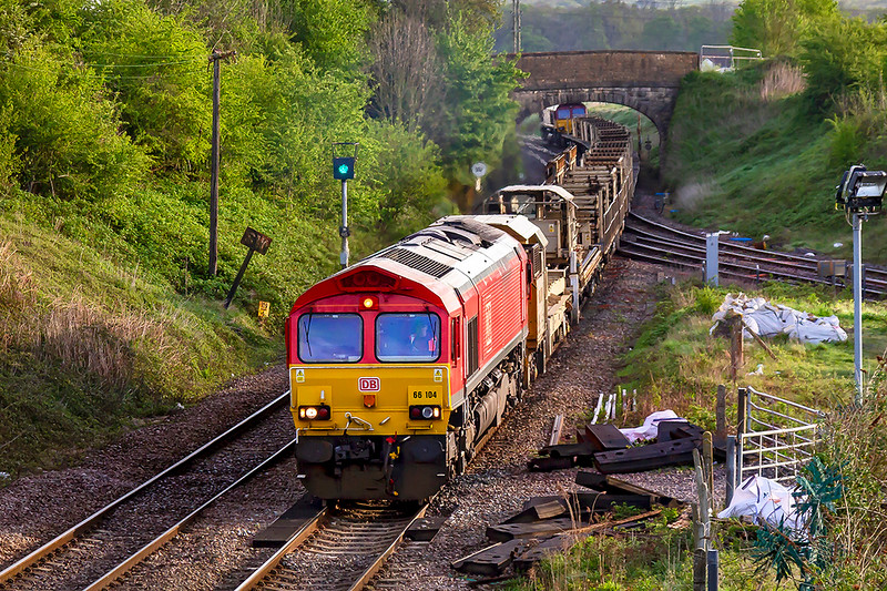 26th Apr 2019: At Hawkeridge Junction working on an empty LWR train from Trefforest to Westbury are 66104 at the front and 66121 on the other end.  Shame about the trackside detrious that Notwork Rail has left there for months.