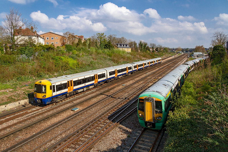 14th Apr 2019:  At Norwood Junction London Overgroung 378144 is forming 2D20 from West Croydon to Highbury while 377201 is working the 2Z36 the 09.58 from Clapham Junction to Epsom Downs