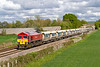 25th Apr 2019: In a very welcome patch of  sunshine 59201, that is in charge of 6V18 from Allington to Whatley Quarry, is at Fairwood as it leaves Westbury.  If the bell end had been leading everything would have been perfect.