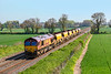 21st Apr 2019:  66086 top 'n tail with 66119 are bringing a set of JJAs  back to Westbury from Dolphin Junction.  The service  listed as 6W01 is pictured from Cowleaze Lane in Edington