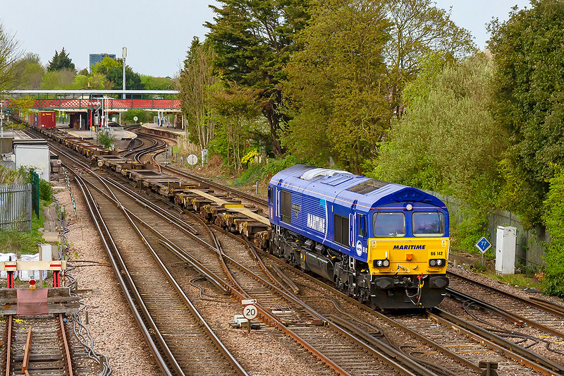 18th Apr 2019: 4O21 started from Trafford Park at 09.12 and now almost nine ours later it is passing through St Denys as it heads to Southampton Western Docks.  Providing the urge  66142 'Maritime Intermodal Three'