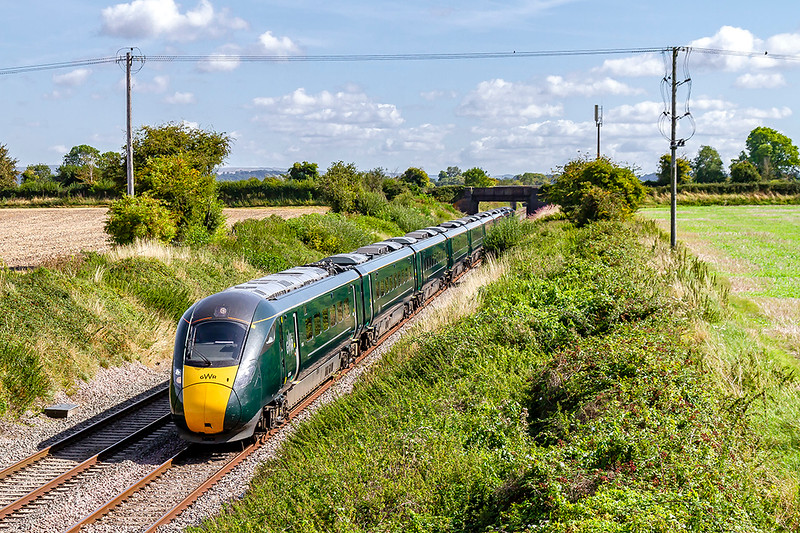 29th Aug 2019:   Like all the other GWR expresses to the West of Englandthe 10.03 to Penzance is formed of an IET in this revolting dull  green livery (abandoned by the propper GWR in 1906). 802107 is doing the honour on 1C76 that is picturd at Edington with the Lambourn Lane bridge in the background