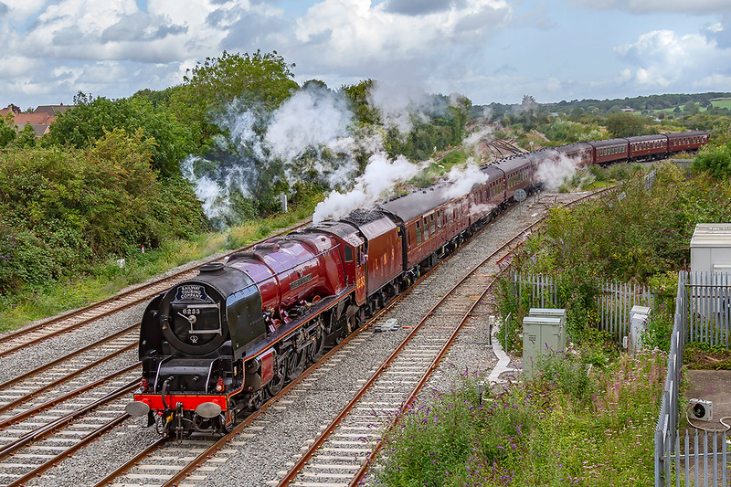17th Aug 2019:  The West Somerset Steam Express is organised by the Railway Touring Company to run from Paddington to Minehead.  Today LMS Pacific 6233 'Duchess of Sutherland' is providing  the urge and is captured as it arives at Wesbury.  It has taken 3 1/4 hours to cover the 97 miles so is not eally an Express.
