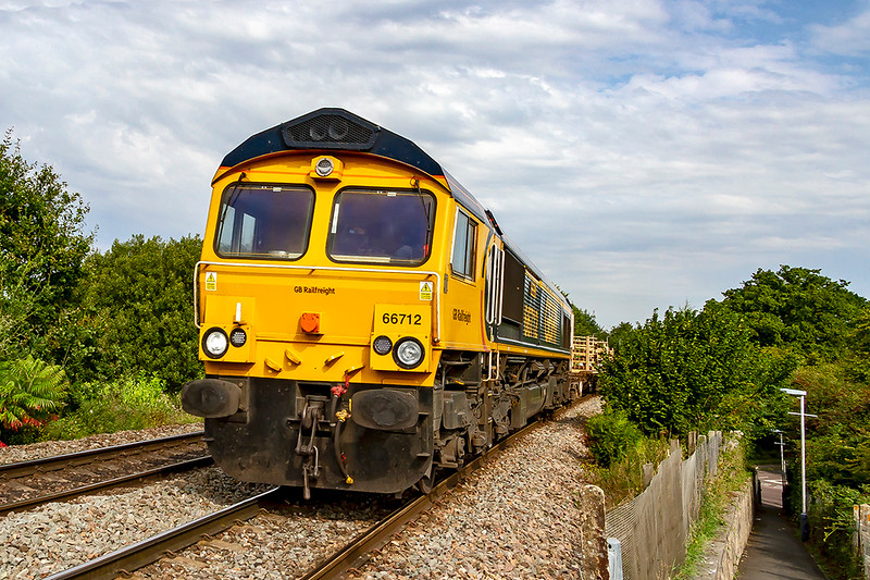 27th Aug 2019:  Powering up the grade through Dilton Marsh is 66712  that is working 6O41 the morning departmenal from Westbury to Eastleigh
