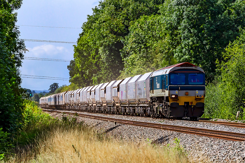 20th Aug 2019:  59103 in charge of 7A77 from Merehead and Theale is runninig 68 minutes late as it approaches Fairwood Junction