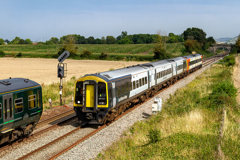 27th Aug 2019:  A points failure on the Mule between Wilton and Yeovil closed the line so services had to be diverted.  155135  forming 2M12 the 14.15 Frome to Swindon is waiting at the signal for a platform in Westbury to clear for it to procede.   SWR 159017 and 158881 left  Waterloo at 12.20 as 1L33 to Exeter  and passed Wilton at 13.51 two minutes late. It was 30 minutes late when it arrives at Yeovil.  This was the reason that 2M12 was held at the signal.