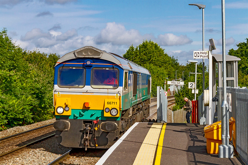 21st Aug 2019:  With nothing on the hook 66711 'Sence' is racing up the grade through Dilton Marsh as it goes to Eastleigh with 0O41 the departmental from Westbury. Well known and respected photographer  at the end of the platform is studying his result.