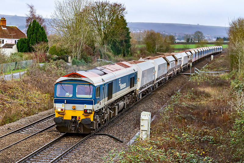 5th Dec 2019:  59103  on the point of 7B12 from Merehad to Wootton Bassett is pictured in Heywood as it accelerates away from Hawkeridge Junction