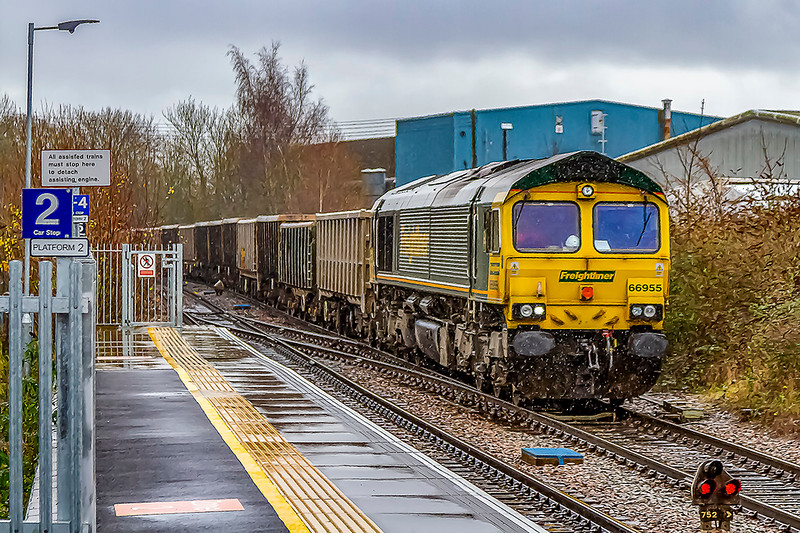 10th Dec 2019:  On a truly horible wet day 66955 working 7V16, the empties fromFareham to Whatley Quarry,  passes through Warminster..