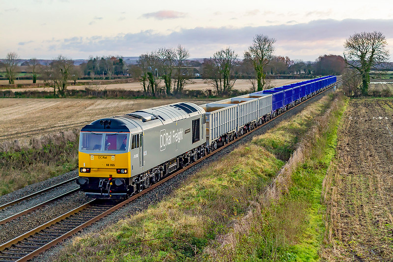 9th Dec 2019:  At 08.13 60055 'Thomas Barnado', newly repainted into DC Rail Freight livery, passes through the fields of Baynton Farm in Edington.  6Z18 is bringing the new wagons  to Westbury from Eastleigh.