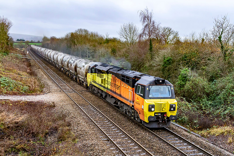 5th Dec 2019:  6C36 is the Tuesdays and Fridays only service to return the empty PCAs to Aberthaw from the Westburry Lafarge cement storage works..  70805 is  pictured at Heywood about half a mile north of Hawkeridge Junction