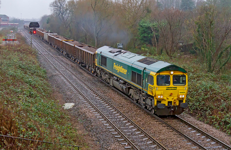 17th Dec 2019:  Despite the rain I considered it worth the effort to get my first picture of 1A15 the 09,24 from Whatley Quarry to Appleford.  66606 is pictured as it nears Hawkeridge  Junction.