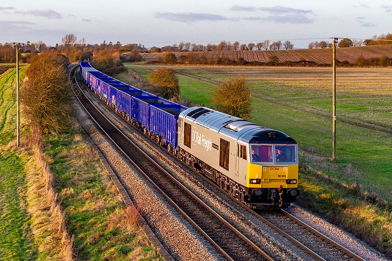 9th Dec 2019: With only a few minutes to spare before sunset 60055 'Thomas Barnardo' reaches the top of the climb from Westbury to Warminster and passes under Granada Bridge on the Warminster Bye Pass.  6Z91 is working to Southampton Up Yard with the brand new JNA wagons on their first commercial duty.  Although only having been in the country for a couple of days some are already  covered in Graffiti.