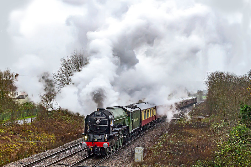 10TH Dec 2109:  On a horrible very wet and very windy morning 60163 accelerates away from Hawkeridge Junction..  The Railway Touring Company's 1Z41 had started  from Paddington at 07.14 and was heading for Cardiff.  There are no prizes for guessing which way the wind was blowing !!